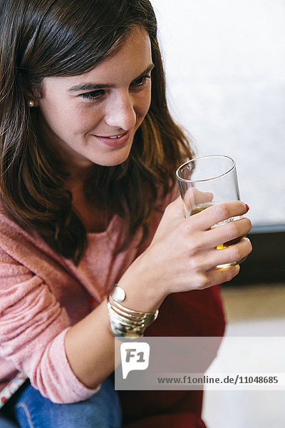 Caucasian woman drinking juice