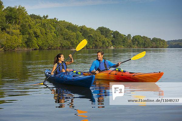 Couple kayaking in river