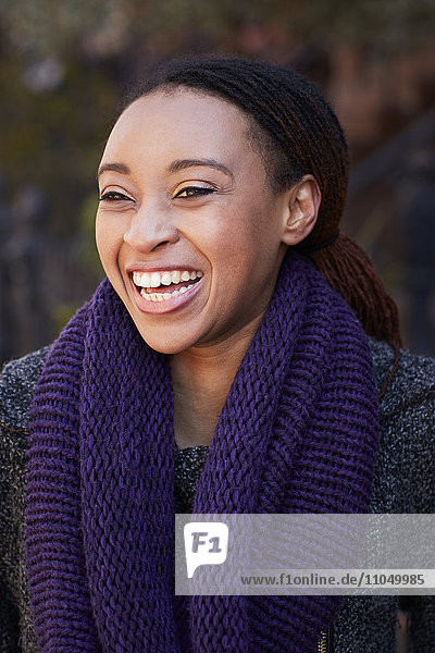 African American woman laughing outdoors