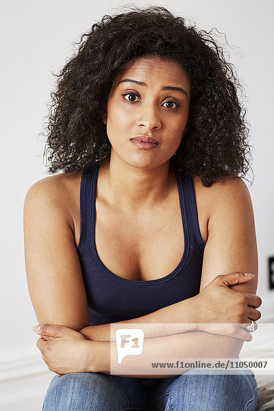 Serious mixed race woman with arms crossed