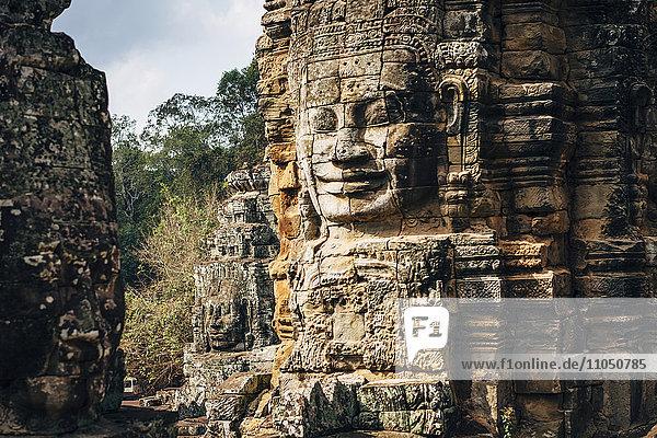 Dilapidated statue and pillar at Angkor Wat  Siem Reap  Cambodia