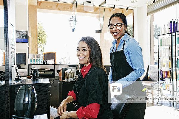 Hairdresser and customer in hair salon