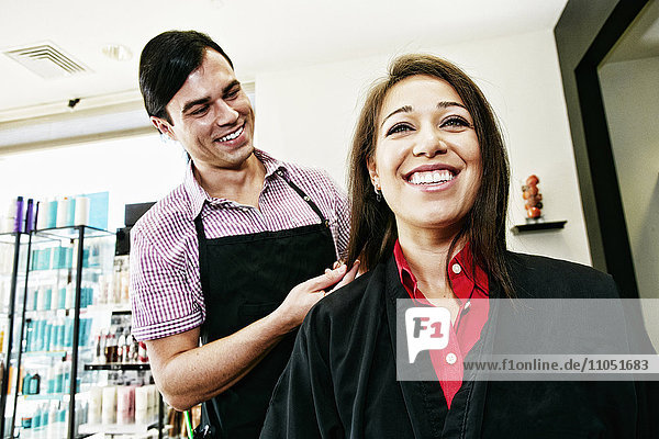 Hairdresser and customer in hair salon