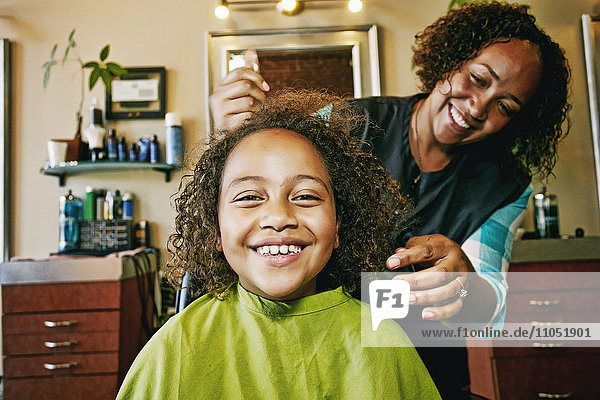Smiling hairdresser and customer in hair salon