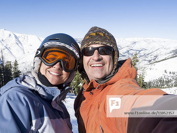 Smiling couple posing for selfie