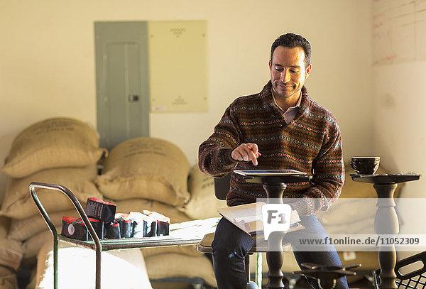 Hispanic entrepreneur using digital tablet