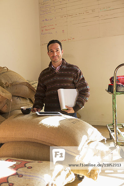Hispanic entrepreneur using digital tablet in store