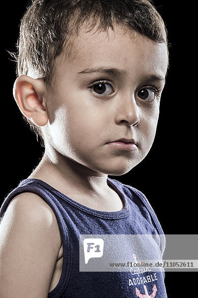 Close up of serious Hispanic boy