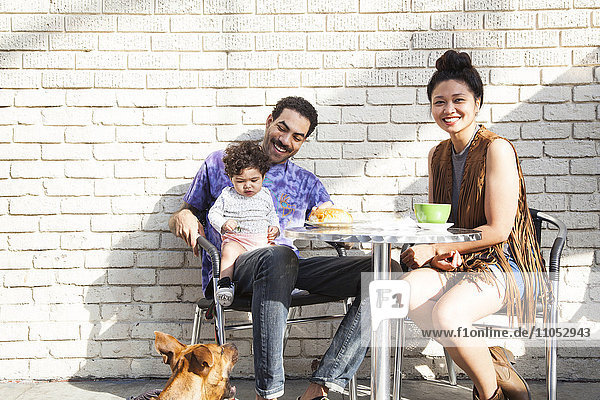 Parents eating with baby son at outdoor cafe