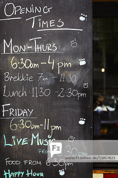 Specialist coffee shop. A chalk board with opening times and events listed.