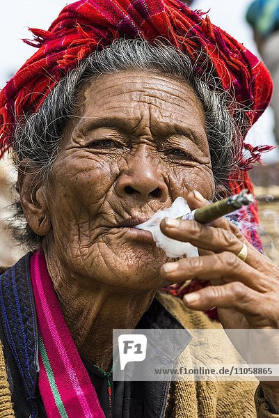 Smoking old woman from the Pao hilltribe or mountain people  portrait  market  Kalaw  Shan State  Myanmar  Burma  Asia
