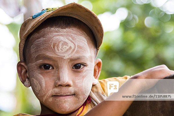 Child with Thanaka paste in the face of mountain tribe or mountain people Pa-O or Pa-Oh or Pao or Black Karen or Taungthu or dew-soo  ethnic minority  portrait  near Kalaw  Shan State  Myanmar  Myanmar  Asia