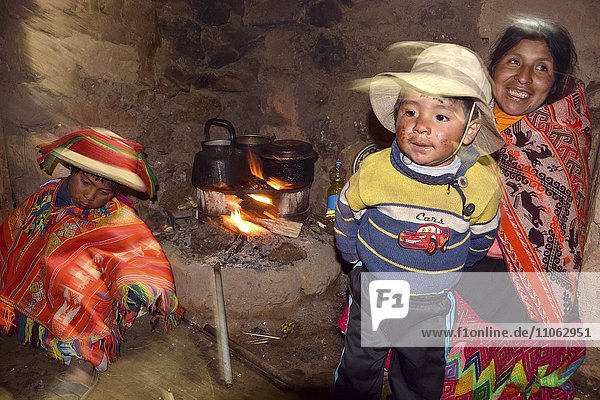 Indio family at the fireplace in their hut  Andes  Lares  near Cusco  Peru  South America