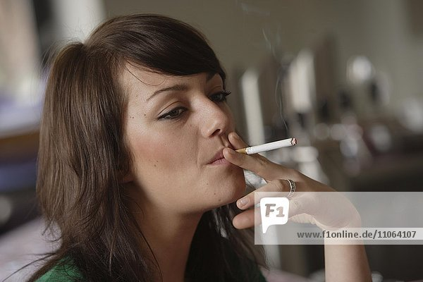 Young woman smoking in a bar or bistro  Germany  Europe