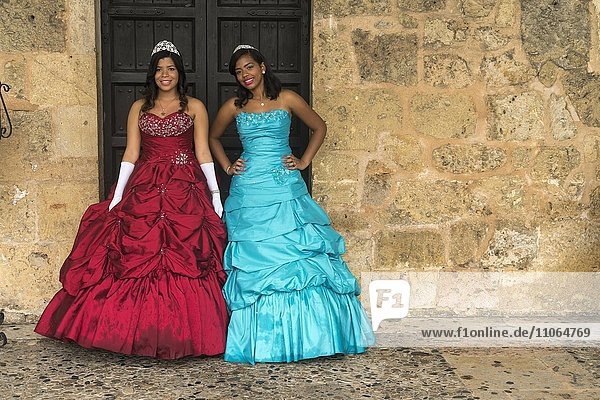 Young women in festive dress celebrate their 15th birthday  the Quinceanera or Quince  capital Santo Domingo  Dominican Republic  North America