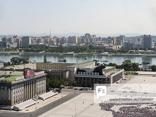 View of Kim Il-sung Square with Taedong River and skyline  to the left the Ministry of Foreign Trade  Pyongyang  North Korea  Asia