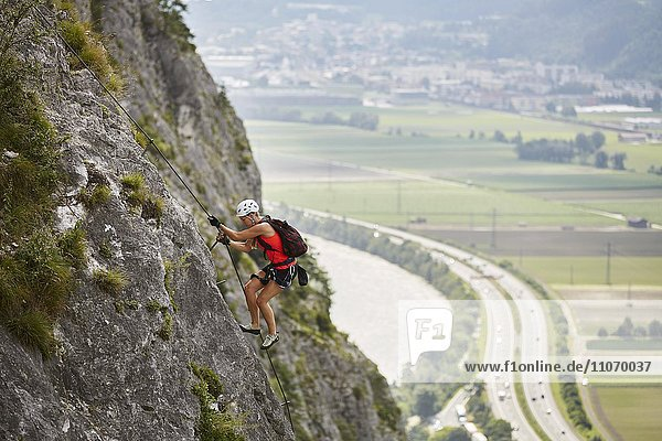 Mountaineer  climber with white helmet climbing the via ferrata  Zirl  Innsbruck  Tyrol  Austria  Europe