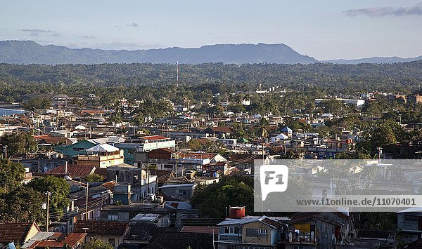 View of the mountain range Sierra del Purial and the city of Baracoa  Guantanamo province  Cuba  North America