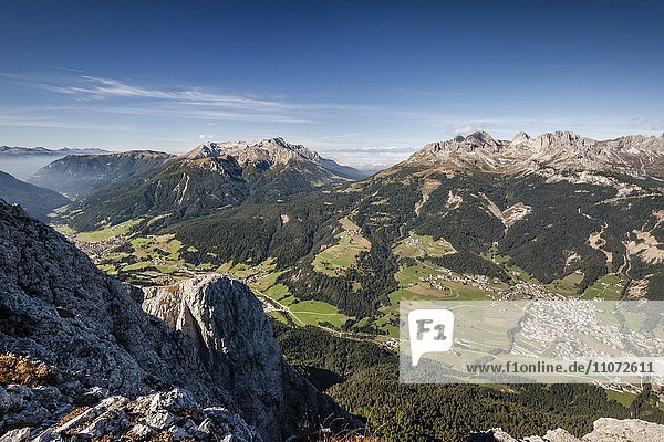 View from the top of Cima Dodici  Sas da le Doudesh in Val San Nicolo di Fassa  behind the Latemar and Rosengarten Group  below the Fassa Valley with the town of Vigo di Fassa and left Moena  Dolomites  Trentino Province  Region of Trentino-Alto Adige  Italy  Europe