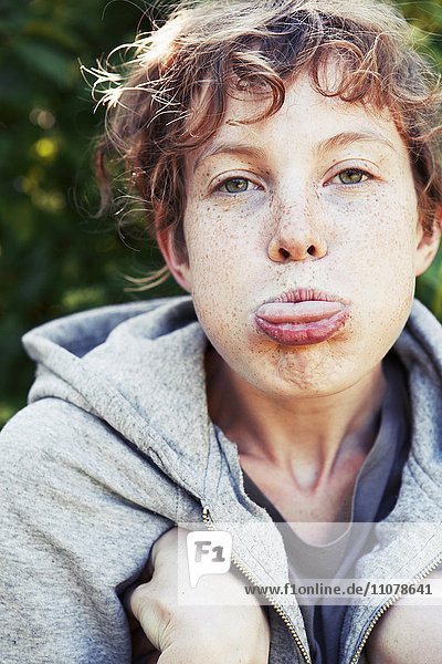 Young woman pulling fully faces