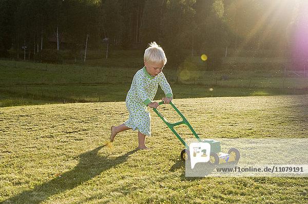 Boy moving lawn