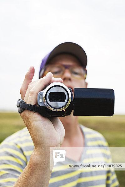 Man filming with camcorder  close-up