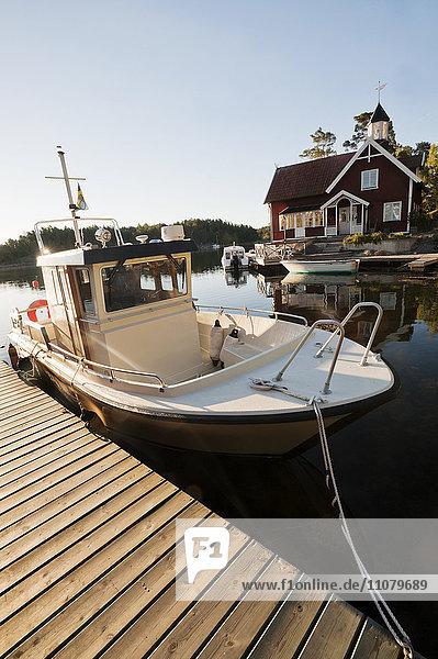 Boat moored near pier