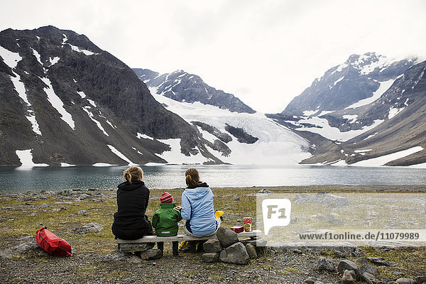Two women with baby looking at view