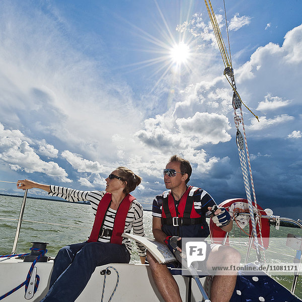 Man and woman sitting in sailing boat