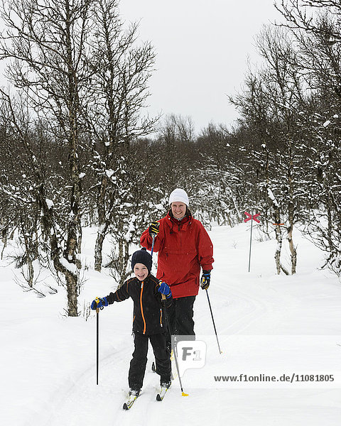 Mother and son cross country skiing