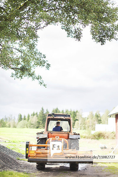 Senior man on tractor  Smaland  Sweden