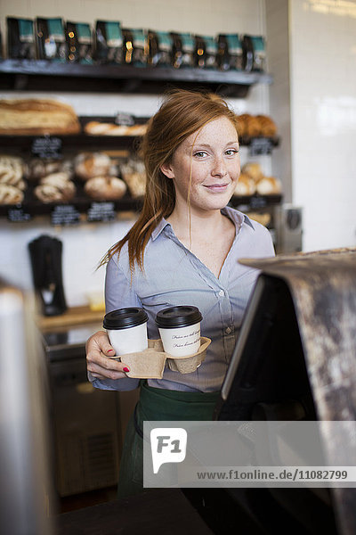 Young woman working in cafe  Stockholm  Sweden
