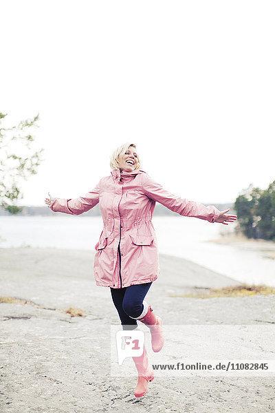 Happy woman in rain