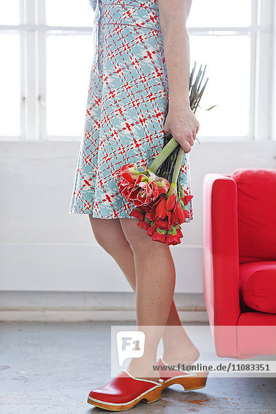 Woman holding bouquet of flowers  close-up