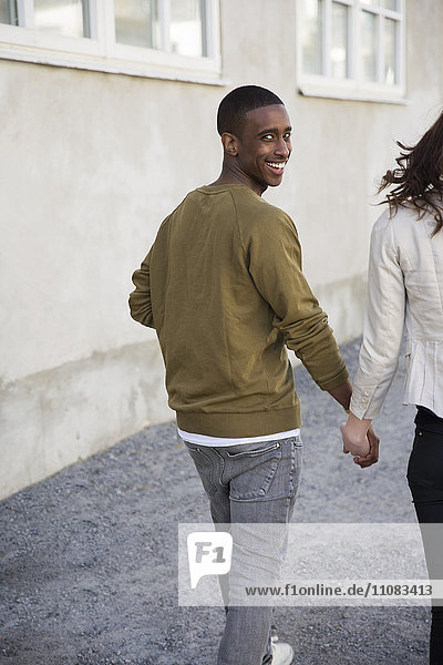 Happy young couple walking