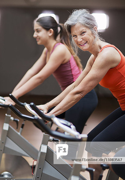 Women riding exercise bikes