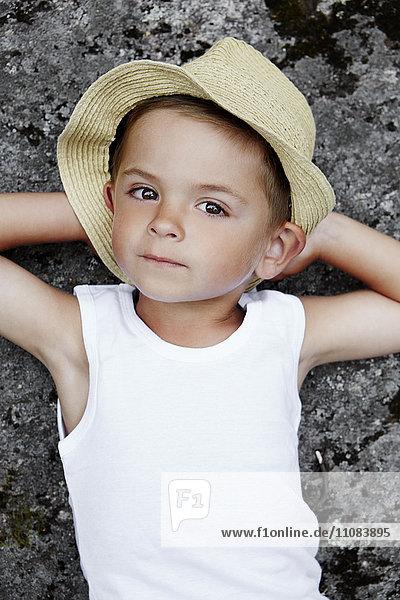 Boy in sun hat looking at camera  Stockholm  Sweden