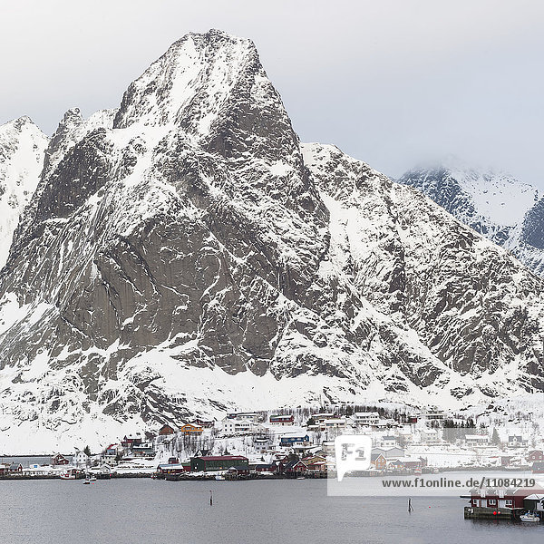 Buildings at coast with mountain in background  Lofoten  Nordland Fylke  Norway
