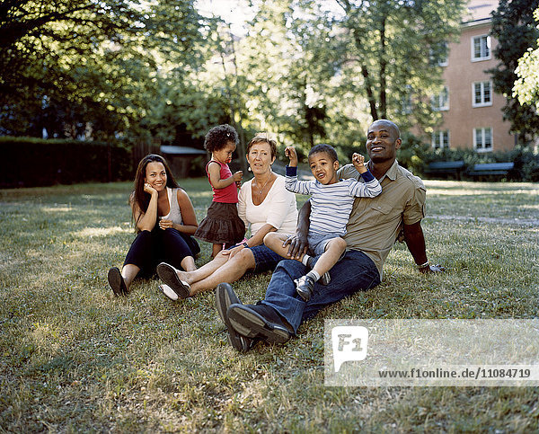 Family sitting on lawn