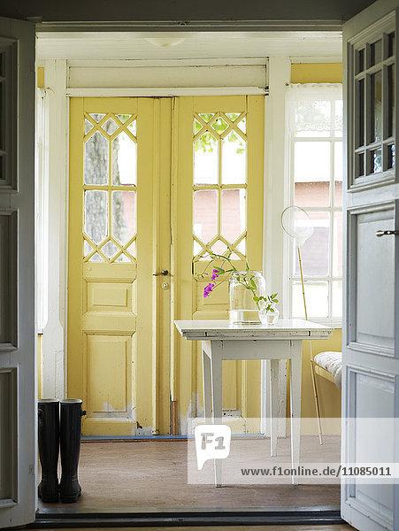 A yellow glass-enclosed veranda  Sweden.
