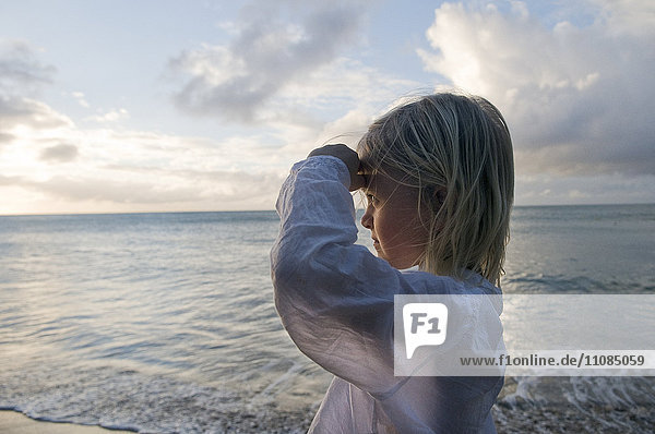 A Scandinavian girl standing by the sea  Guadeloupe.