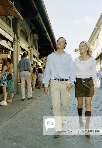 Couple in love walking down a street  Florence  Italy.