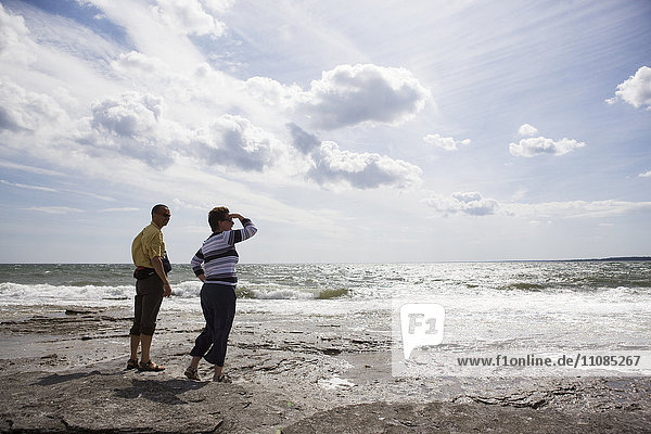 Middle-aged couple by the sea  Sweden.