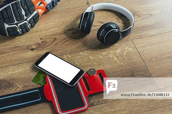 Laufschuh  Kopfhörer  Smartphone und Tasche