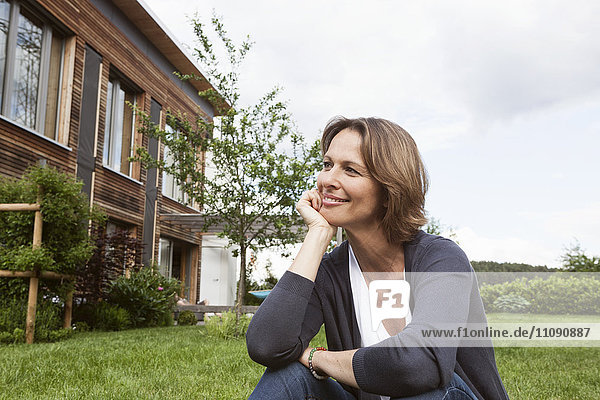 Smiling woman relaxing in garden