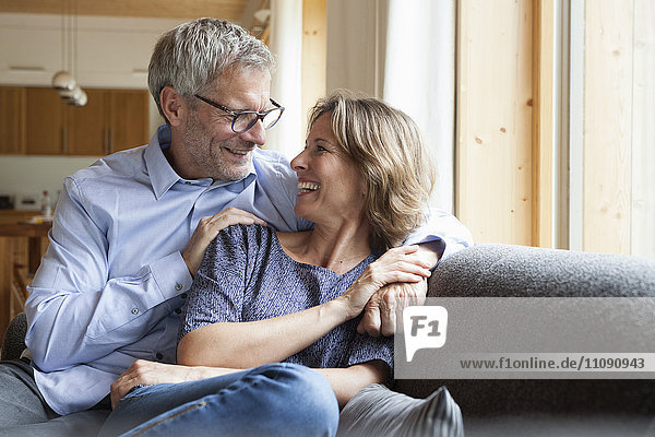 Happy mature couple on couch