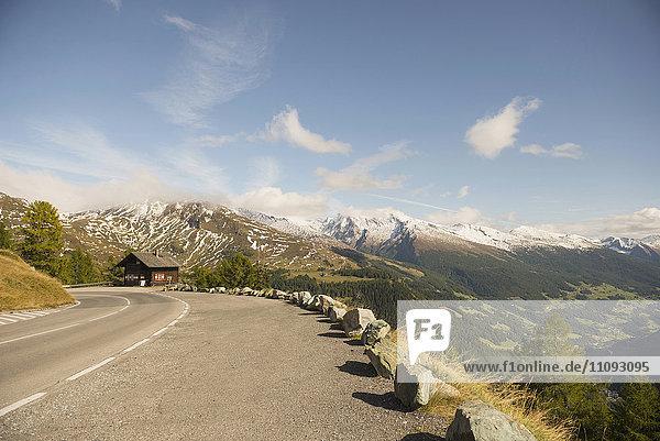 Road passing through mountains against cloudy sky  Grossglockner  Austrian Alps  Carinthia  Austria