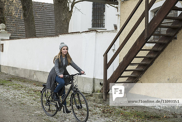 Teenager girl riding a bicycle on street