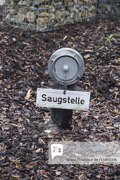 Fire hydrant in garden centre  Augsburg  Bavaria  Germany
