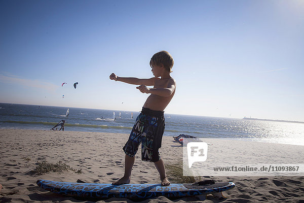 Little child playing on the beach
